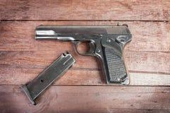 Semi-automatic 9mm gun  on wooden background.  Stock Photo