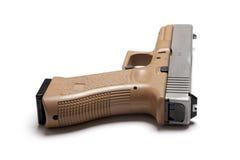 Semi-automatic 9mm pistol. Semi auto 9mm tan color handgun isolated on a white background, studio shot Stock Image