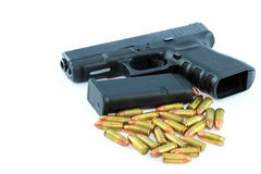 Semi automatic pistol and ammo Stock Photo