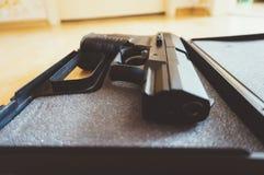 Semi-automatic pistol. Closeup of a semi-automatic pistol in a open box Stock Photo