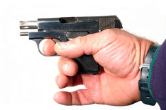 Semi-automatic pistol in hand Stock Images