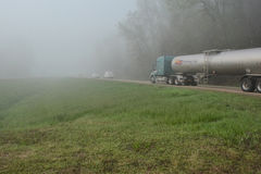 Semi and Cars in Fog 2 royalty free stock photos