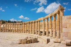 Semi-circle of columns forming a plaza at the ancient ruins Stock Photography