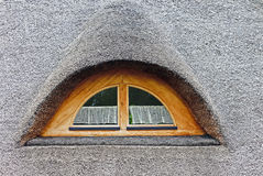 Semi-circular window in the roof of straw Royalty Free Stock Image