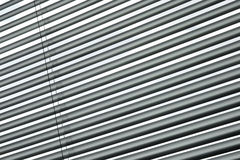 Semi-closed metallic blinds Stock Image