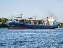 Ship leaving the Port of Hamburg. Semi-container ship CSAV Peru on the Elbe outbound from the Port of Hamburg, Germany stock images