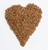 Semi del grano saraceno isolati sopra i precedenti bianchi fotografie stock