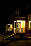 Semi-detached homes at night. A picture of the front porches of two semi-detached homes, brightly lit at night. Taken in the village of Fiskars, Finland Royalty Free Stock Images