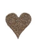 Semi di Chia nella forma del cuore isolati su bianco Immagini Stock