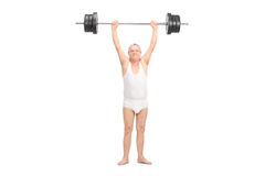 Semi-dressed senior lifting a heavy barbell Royalty Free Stock Images