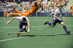 Semi-finals Netherlands vs England. THE HAGUE, NETHERLANDS - JUNE 13: Dutch player Jolie is flying over English field player Lewers, after Lewers tryed take over royalty free stock photography