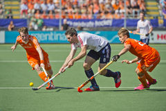 Semi-finals Netherlands vs England. THE HAGUE, NETHERLANDS - JUNE 13: Dutch players Van and De Wijn blocking England striker Simon Mantell during the semi-finals royalty free stock photography