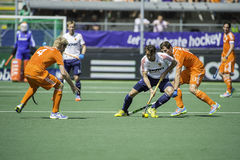 Semi-finals Netherlands vs England. THE HAGUE, NETHERLANDS - JUNE 13: English player David Condon passes Dutch player Sander Baart during the semi-finals of the royalty free stock photos
