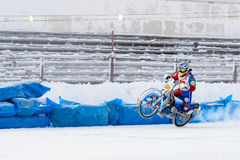 The semi-finals of the Russian championship in Ufa on a speedway  the ice in December 2016. Motocross competition on the ice in Russia Royalty Free Stock Photo