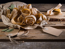 Semi-finished pasta. On a wooden table Stock Images