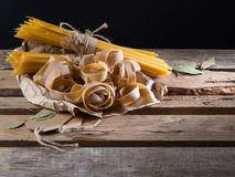 Semi-finished pasta. On a wooden table Royalty Free Stock Photo