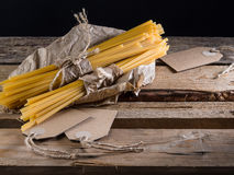 Semi-finished pasta. On a wooden table Stock Photo