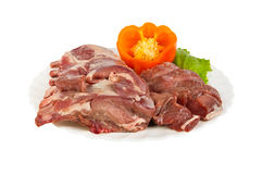 Semi-finished products made of wild boar meat on the plate, isolated Royalty Free Stock Image
