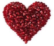 Semi a forma di del melograno del cuore Fotografia Stock