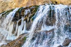 Semi frozen waterfall stock photography