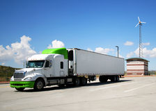 A Semi with Green Highlights and Wind Turbine Stock Photos