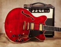 Semi-Hollow Guitar and Amplifier Royalty Free Stock Photos