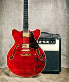 Semi-Hollow Guitar and Amplifier Stock Image