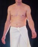 Semi nude male with arm outstretched Royalty Free Stock Image