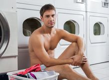 Semi Nude Man With Laundry Basket. Portrait of semi nude man with laundry basket waiting to wash clothes Royalty Free Stock Photo