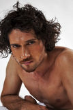 Semi nude portraits of a handsome muscular man Stock Photography