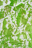 Semi painted wrinkled paper. Green color semi painted wrinkled paper as background. Art is painted by photographer Royalty Free Stock Image