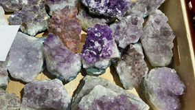 Semi precious amethyst  stones. Natural background semi precious gemma stones Royalty Free Stock Image