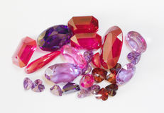 Semi-precious faceted stones. On a white background Royalty Free Stock Photos