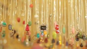Semi precious jewelry stones beads in shop sale stock footage