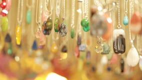 Semi precious jewelry stones beads in shop sale stock video