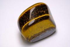 Semi-precious stone. Tiger`s eye royalty free stock image