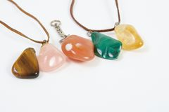 Semi-precious stones against white background. With room for text stock images
