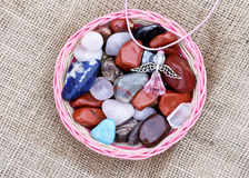 Semi-precious stones and figure of angel Stock Photos