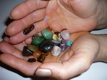 Semi-precious stones. In a woman's hands royalty free stock photos