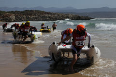 Semi rigid boat race. PLETTENBURG BAY, SOUTH AFRICA - DECEMBER 28: Competitors launch into the waves on 28 December 2009 for the start of the Trans Agulhus Royalty Free Stock Photography