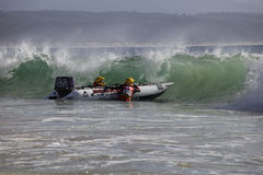 Semi rigid boat race. PLETTENBURG BAY, SOUTH AFRICA - DECEMBER 28: Competitors launch into the waves on 28 December 2009 for the start of the Trans Agulhus Royalty Free Stock Image