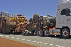 Semi, Road-Train, carring an Iron ore Truck to Newman, with police Escort. royalty free stock images