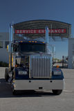 Semi Service. Image of a semi truck parked in front of a service center Stock Photo