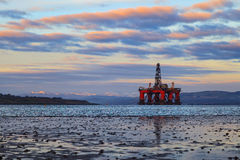 Semi Submersible Oil Rig at Cromarty Firth during Sunset Time Stock Image