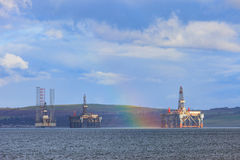 Semi Submersible Oil Rig and Rainbow at Cromarty Firth in Invergordon Royalty Free Stock Photography