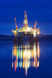 Semi Submersible Oil Rig during Sunrise at Cromarty Firth. In Invergordon, Scotland Stock Image