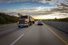 Big dump truck on road. Semi-tractor trailer with dump body on the highway Stock Images
