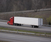 Semi Tractor Trailer Truck. On the Highway Stock Photos