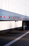 Semi trailer with aerodynamic skirt for fuel savings Stock Image