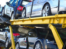 Semi-trailer with brand-new cars. Detail of a semi-trailer with brand-new cars, stacked in two levels, car transporter on the way Royalty Free Stock Photography